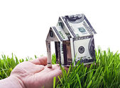 House made of money in hand isolated — Stock Photo