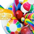 Stock Photo: Colorful candy in a glass isolated
