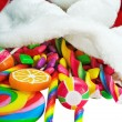 Colorful candy in a Christmas sock — Stock Photo