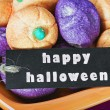 Stock Photo: Halloween candy and black label