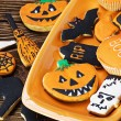 Halloween cookies on orange plate   — Stock Photo