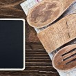 Kitchen utensils and a blackboard to write a recipe — Lizenzfreies Foto