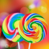 Colorful spiral lollipop isolated on a colored — Stock Photo