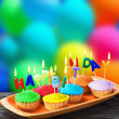 Stock Photo: Happy birthday cupcakes with candles