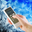 Stock Photo: Air conditioner remote control in hand