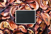 Dry flowers in shades of orange and blackboard — Stock Photo
