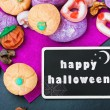 Sweets and candies for Halloween and blackboard — Stock Photo