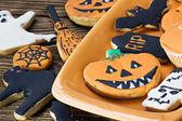 Halloween cookies on orange plate — Stock Photo