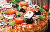 Pizza with salami and olives — Stock Photo