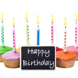 Stock Photo: Colorful happy birthday cupcakes with candles