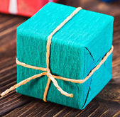 Gift box in a colorful package — Photo