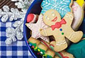 Smiling on the background of Christmas gingerbread decorations — Stock Photo
