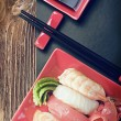 Seafood sushi and chopsticks — Stock Photo