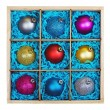 Christmas-tree balls in a wooden box — Stock Photo