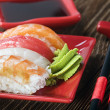 Sushi and chopstick on a red plate — Stock Photo