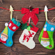 Christmas socks with gifts hanging  — Stock Photo