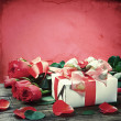 Fresh red roses and gift box — Stock Photo