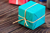 Gift box in a colorful package — Zdjęcie stockowe