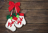 Christmas socks with gifts hanging on the wall — Stock Photo
