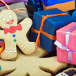 Smiling gingerbread man and Christmas decorations  — Stock Photo