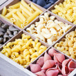 Italian pasta assortment of different colors background — Stock Photo