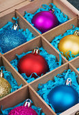 Christmas-tree balls in a wooden box — Foto Stock