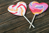Lollipop in form of heart on the table — Stock Photo