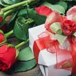 Red roses and gift box for birthday, valentine — Stock Photo