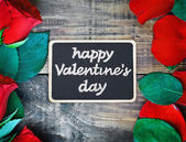 Red roses and blackboard for congratulation — Stock Photo