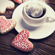 Heart shaped cookies baked on valentines day and a cup of coffee — Stock Photo