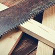 Metal saws and sawn timber on the table. Focus on the teeth of t — Stock Photo