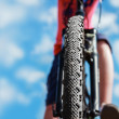 Mountain Bike and blue sky background. Focus on the front wheel. — Stock Photo #38959441