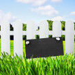 Stock Photo: Blackboard hanging on fence lawn