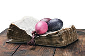 Easter egg and a rosary on an open Bible — Stock Photo
