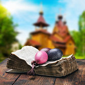 Easter painted eggs on a bible — Stock Photo