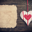 Old paper with heart. toned image — Stock Photo #38960015