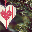 Toy heart hanging on a winter tree. toned image — Stock Photo