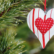 Stock Photo: Toy heart hanging on a winter tree
