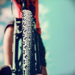 Mountain Bike and blue sky background. Focus on the front wheel. — Stock Photo #40097697