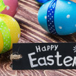 Stock Photo: Painted easter eggs and black label
