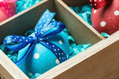 Colorful painted easter eggs in a wooden box — Stock Photo