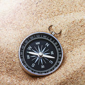 Compass on the hot sand — Stock Photo
