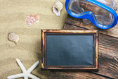 Blackboard and swim mask and snorkel — Stock Photo