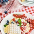 Waffles with berries on the table — Stock Photo