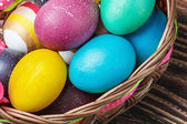 easter eggs in brown basket — Stock Photo
