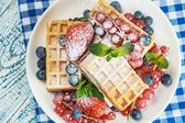 Waffles with fresh berries on the table — Stock Photo
