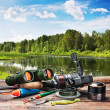 Fishing tackle on a pontoon on the background of the lake  — Stock Photo #42268619