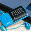 Постер, плакат: MP4 Media Player included with Philips headphones on the table