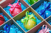 Easter eggs in a wooden box — Stock Photo