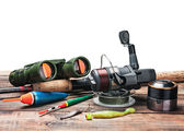 Fishing tackle on the table isolated   — Stock Photo